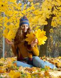 Young woman is walking in the autumn wood Royalty Free Stock Images