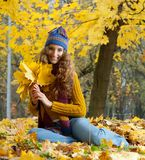 Young woman is walking in the autumn wood Royalty Free Stock Photography