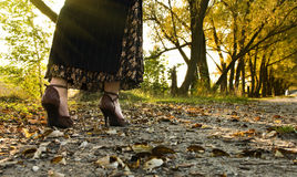 Young woman walking at autumnal park Royalty Free Stock Images