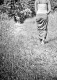 Young woman walking away Stock Photography