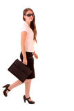 Young woman walking with bag Royalty Free Stock Photo