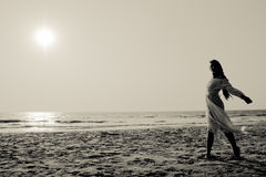 Young woman walking on a beach Royalty Free Stock Photography