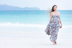 Young woman walking on beach Stock Image
