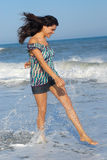 Young woman walking on beach stock photography