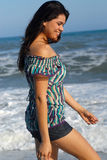 Young woman walking on beach Royalty Free Stock Photos