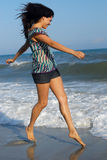 Young woman walking on beach royalty free stock image