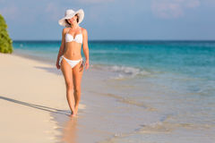 Young woman walking on the beach Royalty Free Stock Photos
