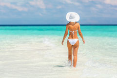 Young woman walking on the beach Stock Image