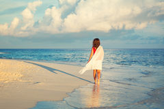 Young woman walking on the beach Stock Photography