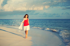Young woman walking on the beach Royalty Free Stock Images