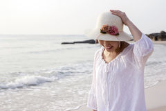 Young woman walking on the beach Royalty Free Stock Photography