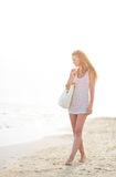Young woman walking on beach in the evening Stock Photography