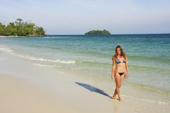 Young woman walking on a beach of Koh Rong island, Cambodia Royalty Free Stock Photo