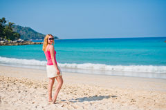 Young woman walking on beach Royalty Free Stock Photo