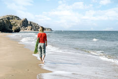 Young woman walking on a beach Royalty Free Stock Image