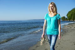Young Woman Walking On Beach Royalty Free Stock Images