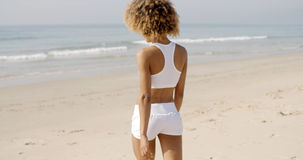 Young Woman Walking On The Beach In Summer Royalty Free Stock Images