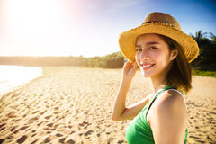 Young woman walking on the beach at sunset Royalty Free Stock Photos