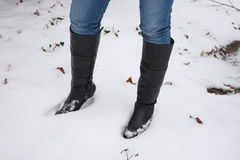 Young woman walking boots in the snow Royalty Free Stock Images