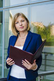 Young woman walking businessman with a folder on the background of business center Stock Photo