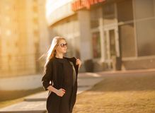 Young woman walking in the city. Stock Images