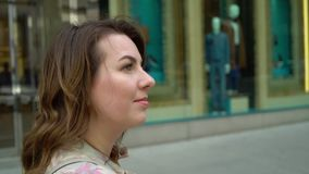 Young woman walking in a city stock video footage