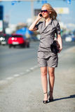 Young woman walking on a city street. Royalty Free Stock Photos