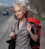 Young woman walking on a city street Stock Image
