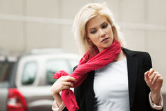 Young woman in red scarf Stock Images