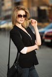 Young woman walking on the city street Stock Image