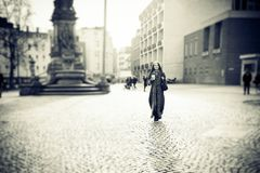 Young Woman Walking In The City Royalty Free Stock Images