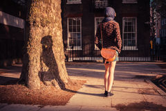 Young woman walking in the city on a sunny day Royalty Free Stock Photos