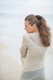 Young woman walking on cold beach. rear view Royalty Free Stock Photos