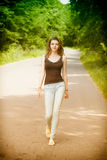 Young woman walking in the countryside Royalty Free Stock Photo