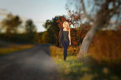 Young woman walking  in the countryside Royalty Free Stock Photos