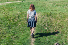 Young woman walking in the countryside Stock Photos