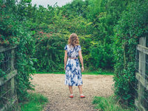Young woman walking in the countryside Stock Photography