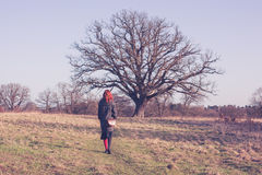 Young woman walking the countryside in winter Stock Images
