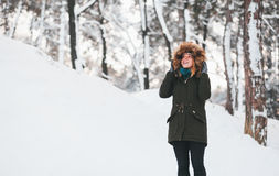 Young woman walking in deep snow Stock Image