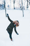 Young woman walking in deep snow Stock Images