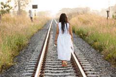 Young woman walking down a railway Royalty Free Stock Photos
