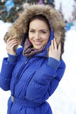 Young woman walking down snow covered street Stock Image