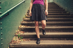 Young woman walking down stairs Royalty Free Stock Photography