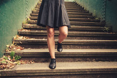 Young woman walking down stairs Royalty Free Stock Photos