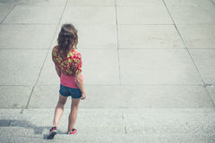 Young woman walking down steps outside Royalty Free Stock Photography