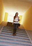 Young Woman Walking Downstairs in Tunnel Stock Images