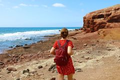 Young woman walking on El Medano in Tenerife, Canary Islands, Spain.  stock image