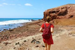 Young woman walking on El Medano in Tenerife, Canary Islands, Spain.  stock photography