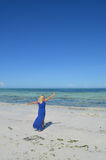 Young woman walking on an exotic beach. Stock Image
