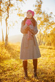 Young woman walking in the fall season. Autumn outdoor portrait Stock Photo